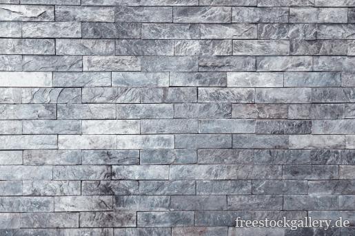 steinmauer mit grauen kleinen steinen kostenloses bild. Black Bedroom Furniture Sets. Home Design Ideas
